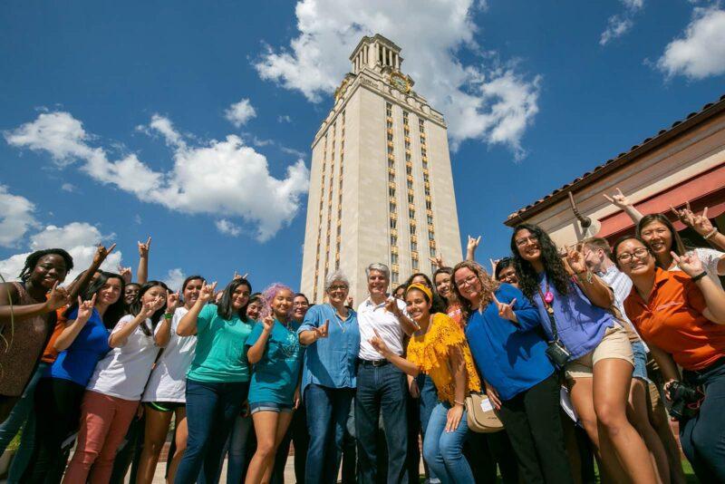 Former UT president Greg Fenves with students