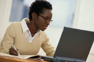 Black woman studying at a computer