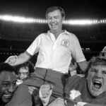 Coach on players' shoulders