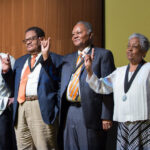 Willie C. Jordan Jr. (far left) raises his horns with a group of Precursors during the 60th anniversary celebration for the first Black undergraduates to enter UT Austin in 1956.