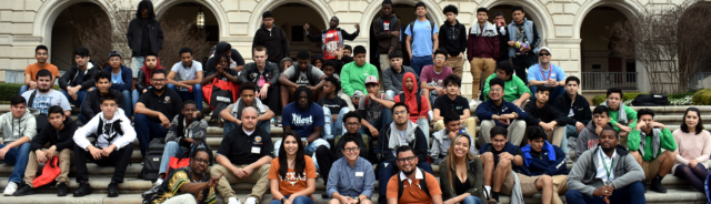 dozens of Project MALES kids sitting on the steps of the UT Tower