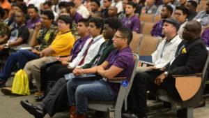 Seated audience in auditorium