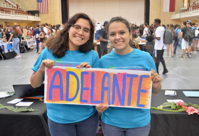 image of two students holding sign