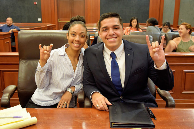 Steven Santoyo and a Huston Tillotson University student show their school. pride at a Discover Law event