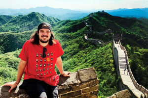Student sitting on the Great Wall of China