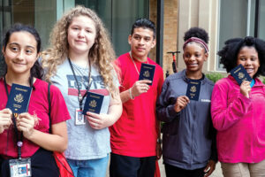 Group photo of middle schoolers with passports