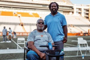 Earl Campbell and Ricky Williams on the UT football feild