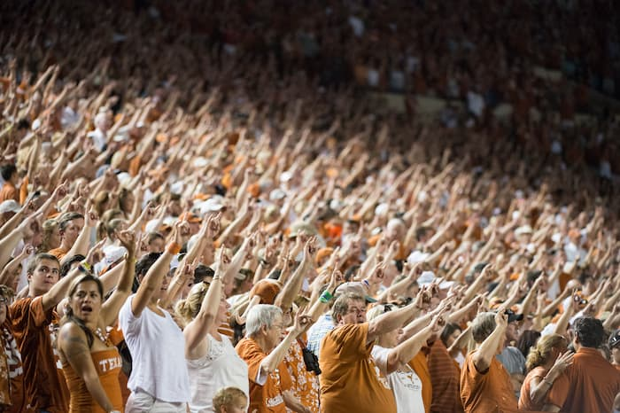Stadium full of fans with Horns Up