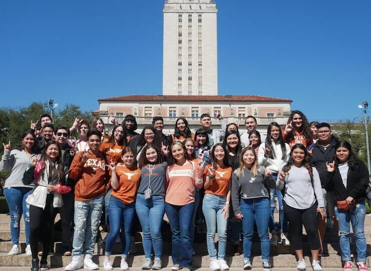 Group of students standing at steps in front of UT Tower