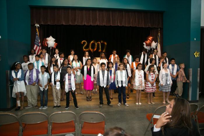 graduates on stage