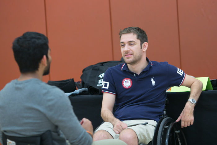 image of student speaking with athlete