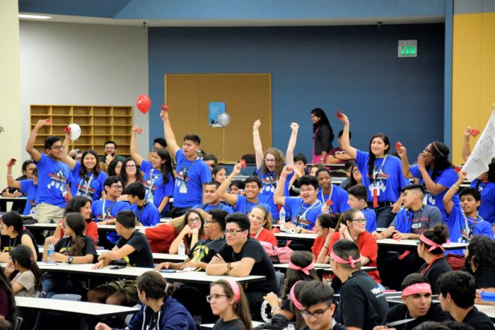 Image of students in blue shirts at Great Debate