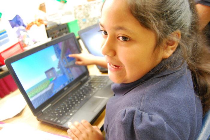 girl pinting at computer