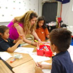 teacher working with group